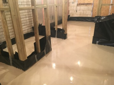Freshly poured floor screed.